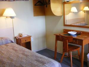 Un ou plusieurs lits dans un hébergement de l'établissement Hotel Motel Bon Accueil