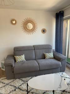 A seating area at Appartement au cœur de Deauville