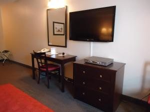 A television and/or entertainment center at La Place Rendez-Vous Hotel