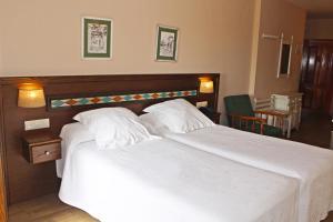 A bed or beds in a room at Finca Los Llanos