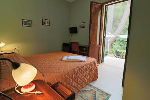 A bed or beds in a room at Dimora Relais Excelsa