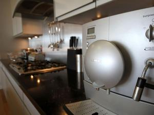 A kitchen or kitchenette at Four The Quay