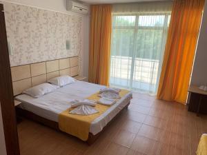 Un pat sau paturi într-o cameră la Vila Elva