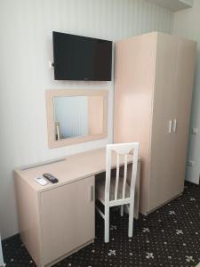 Телевизор и/или развлекательный центр в Отель Афродита