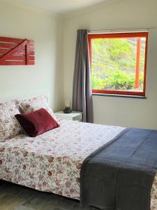 Cama ou camas em um quarto em Casinha de Nesquim