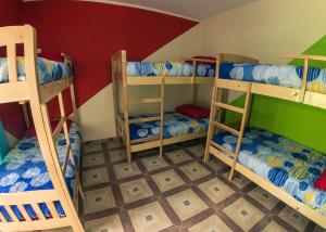 A bunk bed or bunk beds in a room at SOMBRA HOSTEL