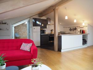 A kitchen or kitchenette at Les Toits du Capitole - Loft de standing 65 m2 - Parking en option