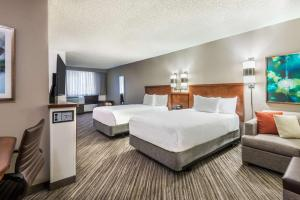 A bed or beds in a room at Hyatt Place Atlanta Duluth Johns Creek