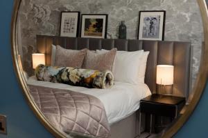 Кровать или кровати в номере Gonville Hotel