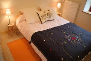 Un ou plusieurs lits dans un hébergement de l'établissement Domaine de Bobehec