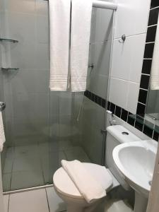 A bathroom at Suites Residence