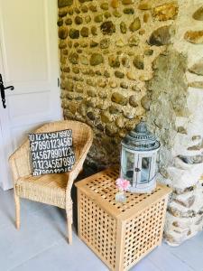 Een zitgedeelte bij Gîtes Les Neuf Cerisiers