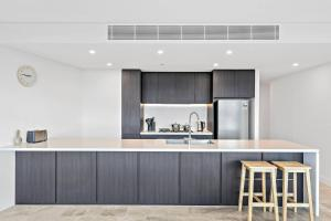 A kitchen or kitchenette at Brand new four bedrooms in Sydney Olympic Park