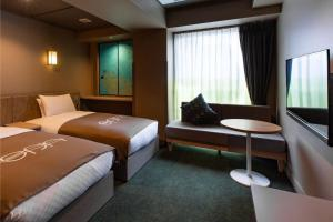 Un ou plusieurs lits dans un hébergement de l'établissement eph TAKAYAMA