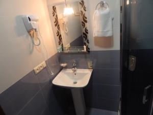 Ванная комната в Hotel Belugo