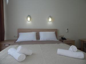Кровать или кровати в номере Hotel Belugo