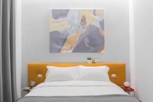 Cama o camas de una habitación en The Radical Hotel Roma