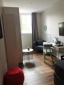 Ein Sitzbereich in der Unterkunft Hotel am Stadtring
