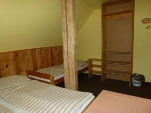 A bed or beds in a room at Chata Šohajka