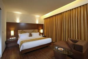 A bed or beds in a room at Indus Biznotel