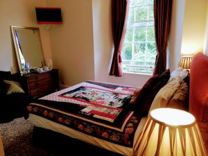 A bed or beds in a room at Picton-House