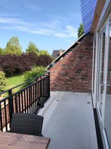 Een balkon of terras bij Vakantie Appartementen De Bonte Kraai
