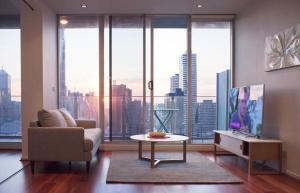 A seating area at 2BR 2BTH + CAR = AMAZING SPACE MELBOURNE CBD VIEWS