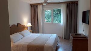 Una cama o camas en una habitación de Hotel Soleado