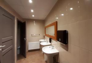 Vannas istaba naktsmītnē Vasaras hotelis Kaija
