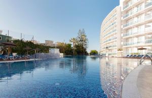Het zwembad bij of vlak bij Hotel Palia Las Palomas