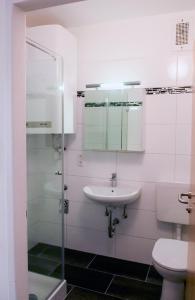 Ein Badezimmer in der Unterkunft Apartment am Bahnhof
