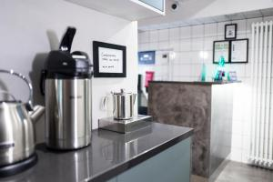 A kitchen or kitchenette at Hotel Finn
