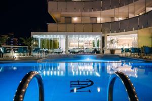 The swimming pool at or near Waldorf Palace Hotel