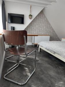 Ein Sitzbereich in der Unterkunft Hoogland aan Zee