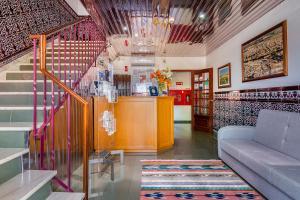 A área de receção ou átrio de Graca Hotel