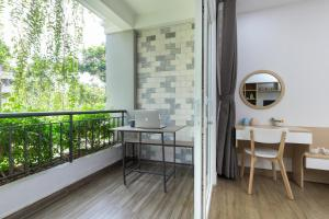 A balcony or terrace at Cozrum Homes - Yoga Corner