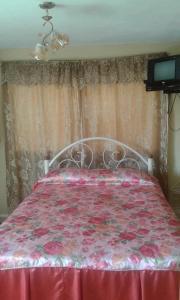 Un ou plusieurs lits dans un hébergement de l'établissement Hostal Villa Barcelo