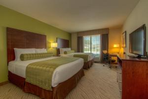 A bed or beds in a room at Cobblestone Inn & Suites - Holyoke