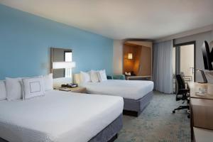 A bed or beds in a room at Courtyard by Marriott Isla Verde Beach Resort