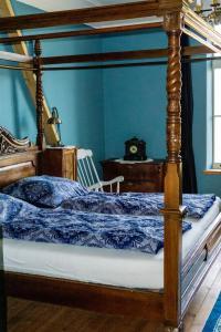 Cama o camas de una habitación en B&B Mühlenvilla am Bützower Hafen