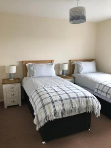 A bed or beds in a room at Heb Holiday, Self Catering Accommodation, Isle of Benbecula