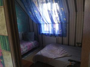 "A bed or beds in a room at ""Нинель"""