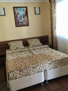 Кровать или кровати в номере Гостевой дом Брауни