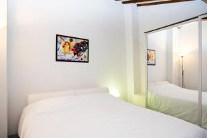 Cama o camas de una habitación en Istay - Appartamenti Sole & Luna