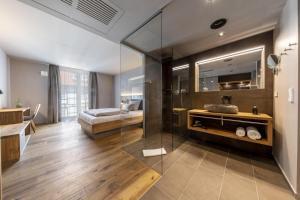 Ein Badezimmer in der Unterkunft AKZENT Hotel Laupheimer Hof
