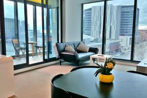 A seating area at 2BR 2BATH + CAR = QUALITY & STYLE IN MELBOURNE CBD