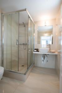 Salle de bains dans l'établissement Hotel Charissi