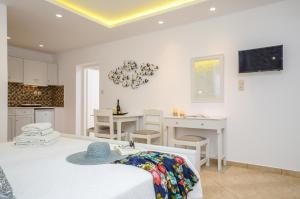 Ein Bett oder Betten in einem Zimmer der Unterkunft Summer Memories Studios