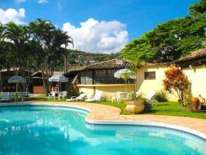 The swimming pool at or near VELINN Pousada dos Marinheiros