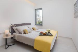 A bed or beds in a room at Luxury Design Beach Front Apartment